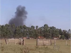 Smoke rises in the distance as Kurusu Mba community burns.