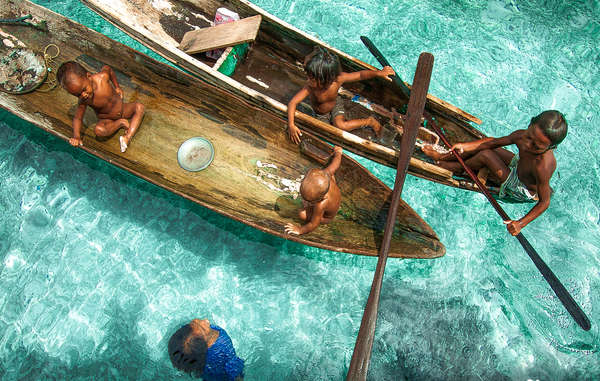 """This beautiful image of the Bajau in Malaysia is the winning entry of Survival's annual photography competition, and features on the cover of Survival's 2016 calendar. """