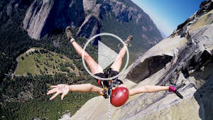 Survival campaigner Tesia Bobrycki suspended in mid-air from El Capitan in Yosemite National Park to launch Survival's 'Stop the Con' campaign.