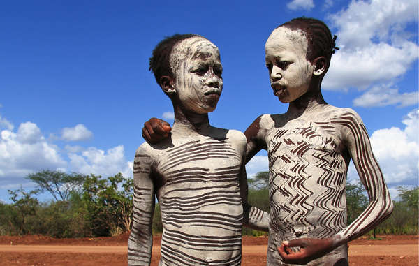 Young Hamar boys painted with white ash, Omo Valley, Ethiopia. The Gibe III dam that is being constructed will destroy their people&apos;s livelihood.