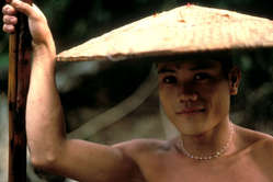 A Penan man in the Borneo rainforest.