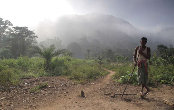 A Dongria boy stands in front of Niyamgiri, where the tribe will hold its festival.