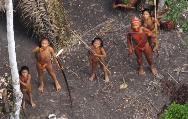 Uncontacted tribes, like this one pictured in aerial footage seen around the world in 2011, now face genocidal attacks as Brazil's government slashes funding for protection of their land.