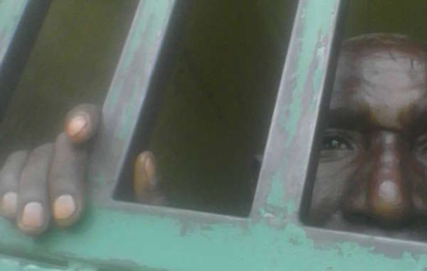 Kafukuzi Valence in his cell in Kisoro, Uganda. 2017