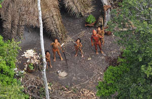 Highly vulnerable uncontacted Indians have made contact with a settled indigenous community close to where these Indians were photographed from the air in 2010.