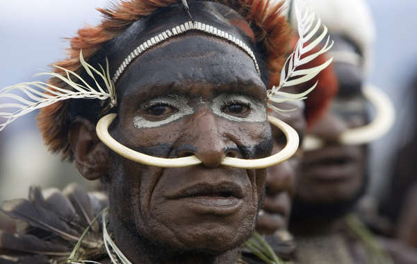 A Dani man from the Baliem Valley performing a traditional ceremony.