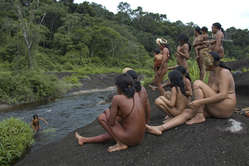 A group of Zo'é rest by one of their favourite rivers, Brazil.