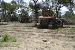 Bulldozers used for illegal deforestation, photographed by government investigators