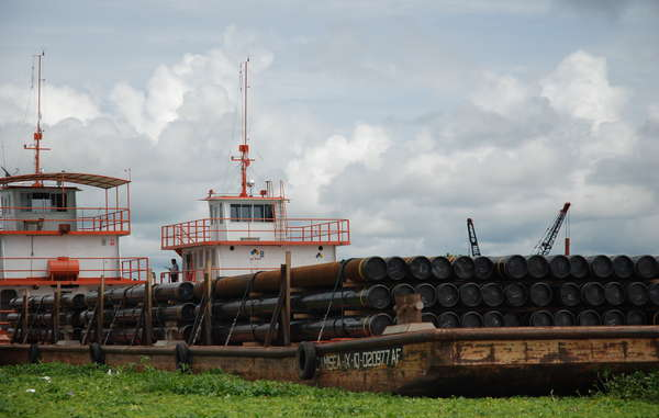 Oil industry barges are a constant sight on the rivers of northern Peru
