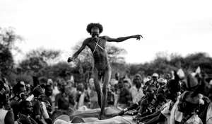 A Hamar man in Ethiopia's Lower Omo Valley has to jump over a line of cattle four times before getting married.