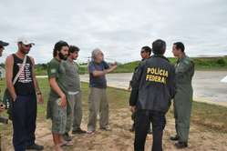 Jos Carlos Meirelles and Brazilian police at FUNAI &apos;s remote outpost on the Envira river, invaded by drug traffickers.