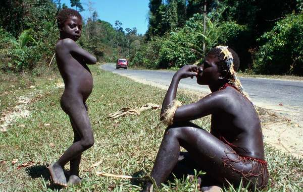 A Jarawa woman and boy by the side of the Andaman Trunk Road