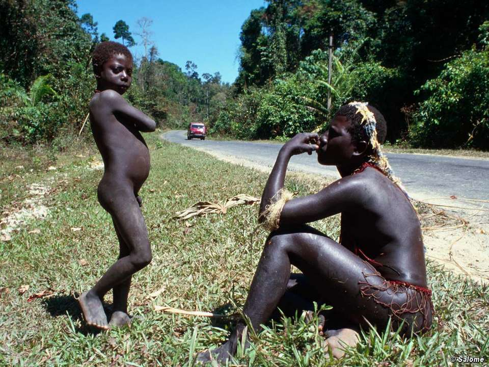 A Jarawa man and boy by the side of the Andamans Trunk Road