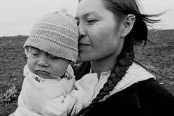 Guarani mother and child. The sugarcane boom is threatening the lives of the Guarani.