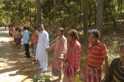 The Dongria Kondh form a human chain to express their opposition to Vedanta\'s mine.