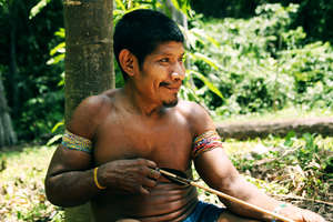 Awá man making arrows, Brazil. The Awá have an intimate knowledge of their rainforest and are extremely skilled hunters.
