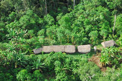 One of the photos in Survival's new report. These houses were built by uncontacted Indians who have been fleeing from Peru to Brazil.