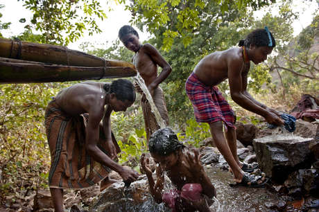 A group of Dongria Kondhs taking a bath in the river in Kunakadu village, Niyamgiri Hills, Orissa, India.