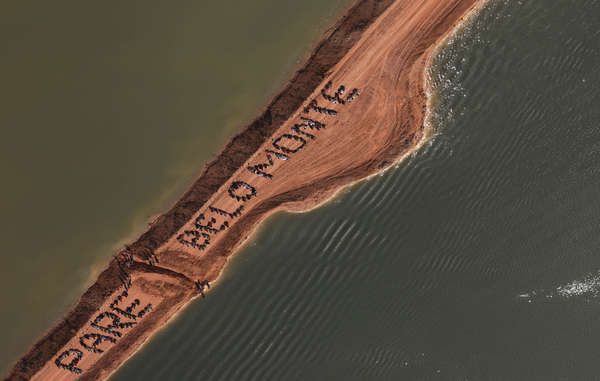 Three hundred indigenous people, small farmers, fisherfolk, and local residents call for the halting of the Belo Monte Dam project while occupying the site and removing a strip of earth to restore the Xingu river's natural flow, Brazil, 2012. The occupation took place during the UN Rio+20 Summit.
