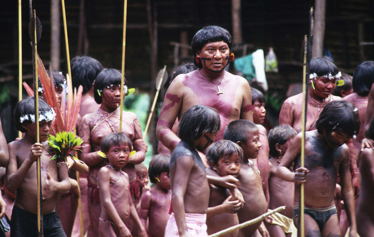 Davi Kopenawa, Yanomami leader and shaman surrounded by children, Demini, Brazil.