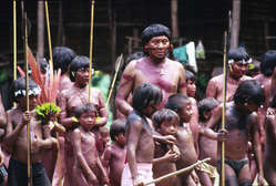 Davi Kopenawa, indigenous leader and shaman, surrounded by children in Demini, Brazil