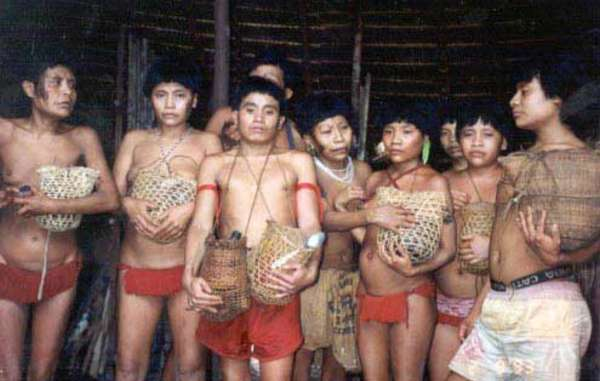 Survivors of the 1993 Haximu massacre hold urns containing the ashes of their relatives. Goldminers killed 16 Yanomami in the attack.