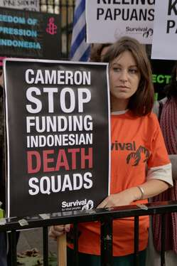 Protester holding banner reading Cameron stop funding Indonesian death squads to mark the visit of Indonesia's President to the UK.