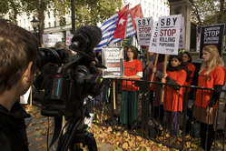 Protesters held banners reading 'SBY-stop killing Papuans', and 'Cameron stop funding Indonesian death squads'.