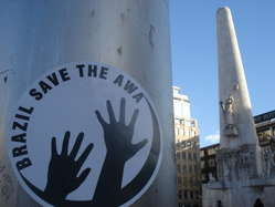 Activists in the Netherlands placed stencils of 'Save the Awá' around Dam square in Amsterdam.