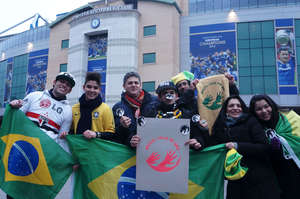 Brazil's soccer fans brandishing the awáIcon, which reads 'Brazil: Save the Awá'.
