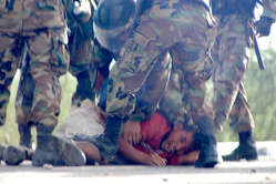 """A wounded protester is beaten by police, Bagua, Peru"""