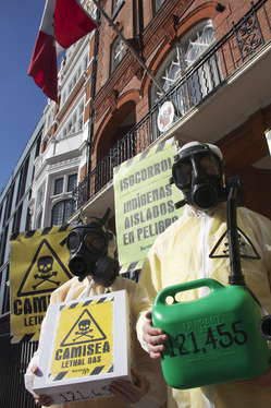 Protesters in London wearing gas masks and carrying placards to symbolize the lethal effects of the Camisea project on Peru's uncontacted tribes.