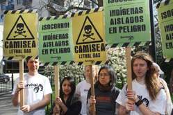 Protesters in London carrying placards to symbolize the lethal effects of the Camisea project on Peru's uncontacted tribes.