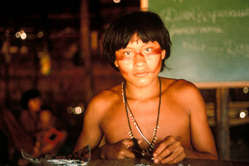 14-year-old Geraldo Yanomami making a necklace from porcupine quills, Demini, Brazil.