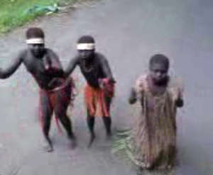 Still of video showing Jarawa girls forced to dance for tourists.