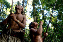 Penan men in the forest.