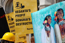 Protestors wave placards outside Vedanta's 2009 AGM.