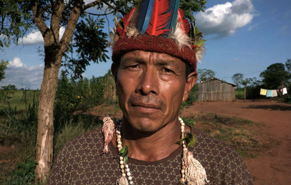 """Guarani man. Tribes across Brazil are expressing their anger at a draft bill which would open up their territories for industrial projects."""