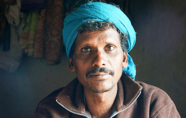 This man's whole community was evicted from Kanha Tiger Reserve. Villagers report that guards threatened to release elephants on them.