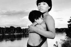 Yanomami mother and child alongside the river.