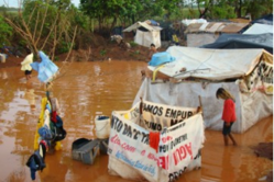Floods engulf the Guarani community of Laranjeira Ñanderu who are forced to camp by the side of a road after being evicted from their land. The lives of the Guarani are being seriously damaged by the denial of land rights.
