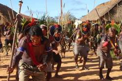 Kayapó Indians dance at a protest against the Belo Monte dam
