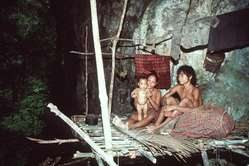 A family of Taut Batu (People of the Cave) at the entrance of Pangi-Pangi cave, in Singnapan Valley.