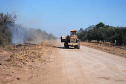 A bulldozer works on a road built through Ayoreo-Totobiegosode land, Paraguay