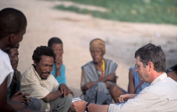 """Survival's Director Stephen Corry with Bushmen of the central Kalahari. """