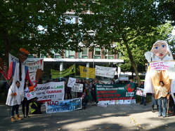 """Supporters of Survival, FIAN and other NGOs held a protest in Berlin against Brazil's assault on indigenous rights."""