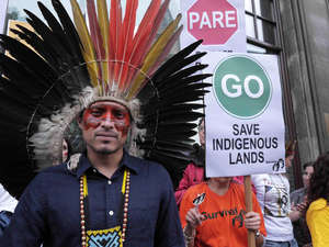Wearing his traditional headdress and facial decoration, Nixiwaka led a protest against Brazil's assault on indigenous rights in London in October 2013.