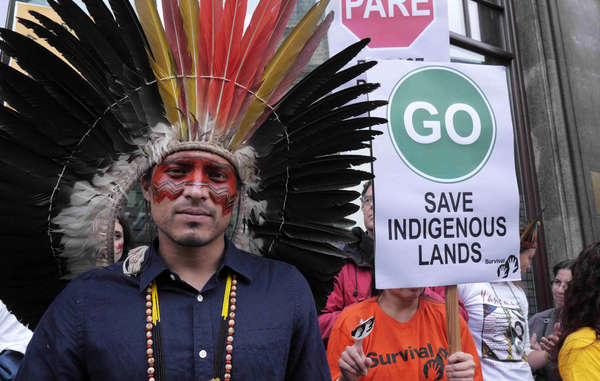 """Wearing his traditional headdress and facial decoration, Nixiwaka led a protest against Brazil's assault on indigenous rights in London in October 2013. """