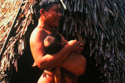 Korubo mother and child in the Javari Valley around the time of first contact in the mid nineties, Brazil. Located on the border of Brazil and Peru, the Javari Valley is home to seven contacted peoples and about seven uncontacted Indian groups, one of the largest concentrations of isolated peoples in Brazil.