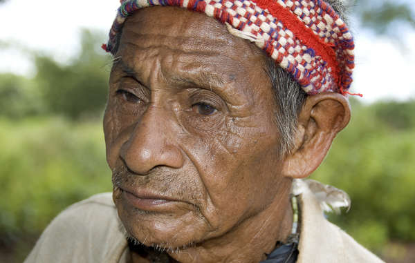 Guarani man. Gunmen have taken up positions around a Guarani community, and fired shots.